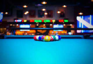 Pool table setup with precise level in Minneapolis